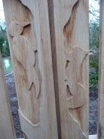 Carved animals on Wildlife Enclosure gates by Jennie kettlewell